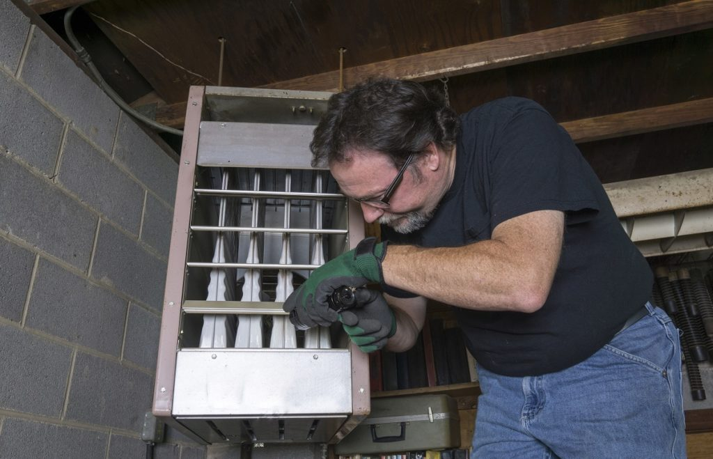 Man fixing a furnace