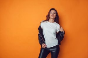 woman with leather jacket and pants posing